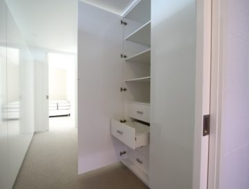Full cabinetry with doors over