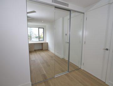 Semi frameless mirror